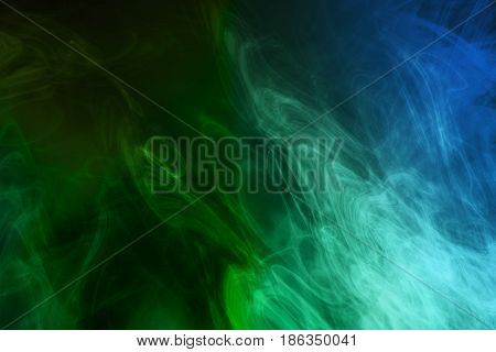 Green and blue smoke background, close - up.