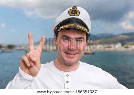 Happy Captain With Sailor Cap Showing Victory Sign