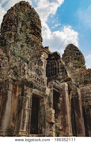 Long corridors and doorway of Prasat Bayon the central temple of Angkor Thom Complex, Siem Reap, Cambodia. Ancient Khmer temple with frescoes and columns, World Heritage.