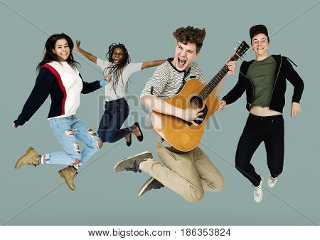 Young Adult People Jumping with Guitar Studio Portrait