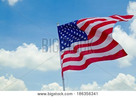 United States flag.have blue sky background.United States flag.have blue sky background.