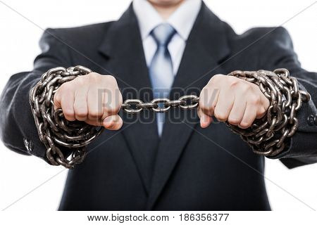 Business problems and failure at work concept - businessman struggles metal chain knot tied hands white isolated