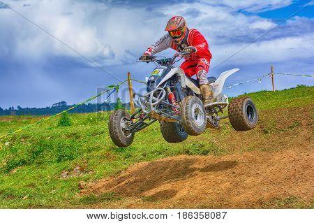 Unidentified Racer Rides A Quad Motorbike.