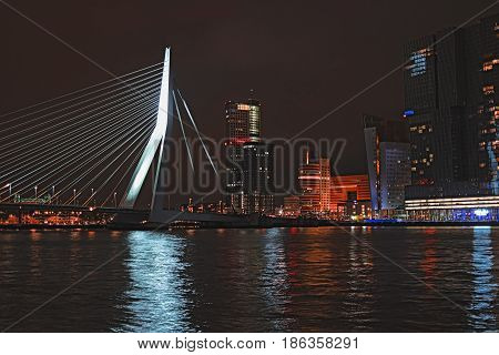 Rotterdam skyline with Erasmus bridge at night Netherlands Europe. Cityscape at dusk. Skyscrapers and bridge over the river Meuse in city centre at twilight Rotterdam South Holland province