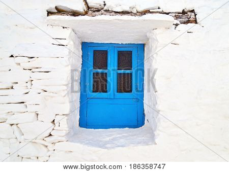 Cyclades architecture - traditional blue window at Sifnos island Greece