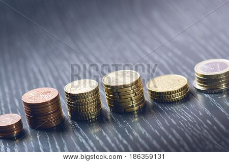 Euro money. Coins are isolated on a dark background. Currency of Europe. Balance of money. Building from coins. Coins of different values
