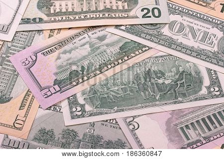 Abstract Dollar Bills Of Different Denominations Background.