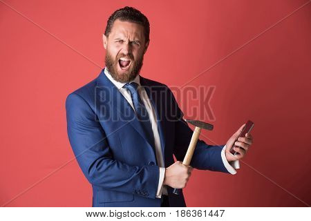 Shouting Businessman Crushing Mobile Phone With Hammer, Overtime, Crash Test