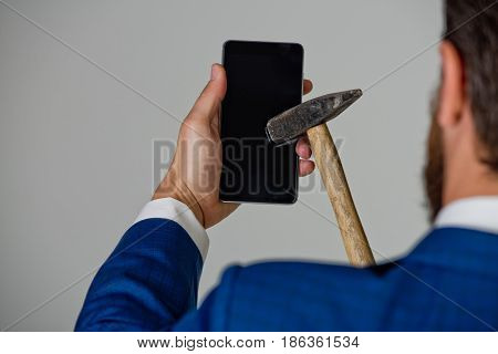 Smartphone, Hammer In Hand Of Businessman, Man Crushing Mobile Device