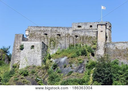 View at walls of medieval Castle Bouillon in Belgian Ardennes