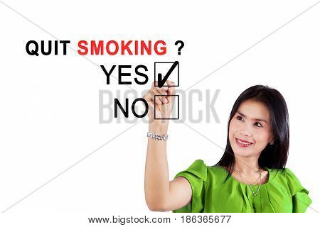 Image of Asian woman using a pen while agreeing about quit smoking on the whiteboard