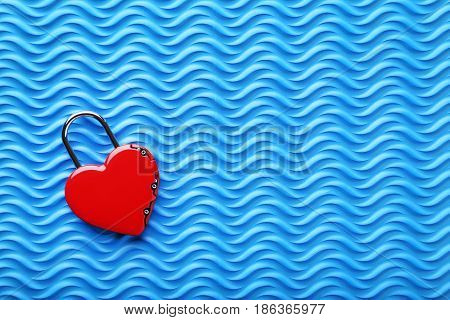 Heart shaped padlock on the blue background
