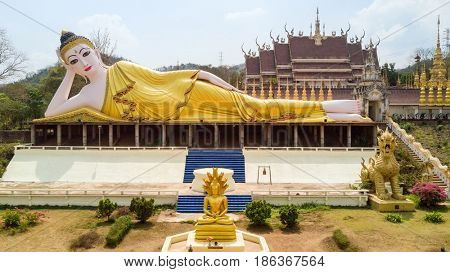 Aerial view of Suthon Mongkol Khiri temple and the reclining golden Buddha statue in the Phrae province, Thailand