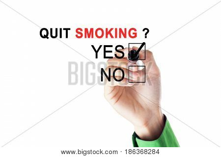 Hands of a businessman using a marker while choosing a yes option for about the question of quit smoking on the whiteboard