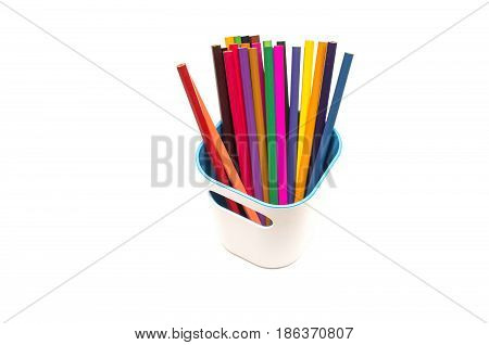 Color pencils in pencil holder isolated on white background.