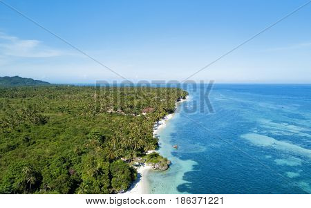 Aerial view of coast, turquoise sea and white sand beach. Bohol, Philippines 2016.