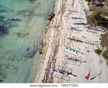 Aerial view of beach with bangkas fishing boats. Bohol, Philippines 2016.
