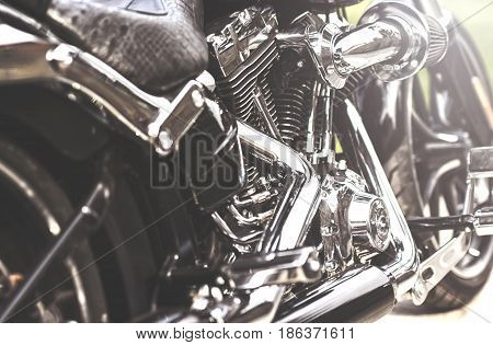 Shiny chrome motorcycle engine block. Color of vintage tone and soft focus.