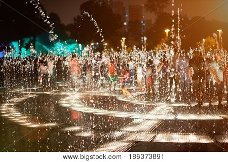 Water Fountain Splashes At Night
