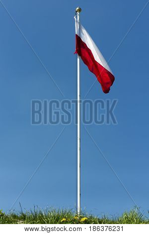 Polish national flag at the summit of liberation mound in Piekary Slaskie