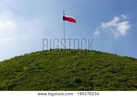 Polish national flag at the summit of liberation mound in Piekary Slaskie