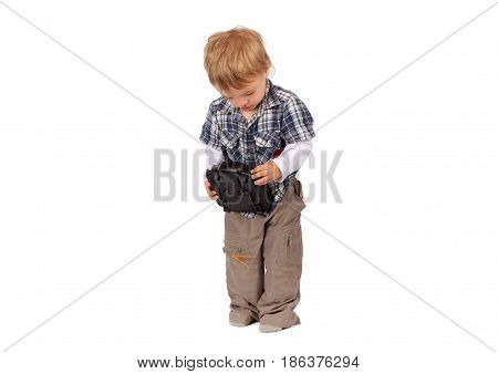 Toddler boy with drone remote control. Isolated on white.