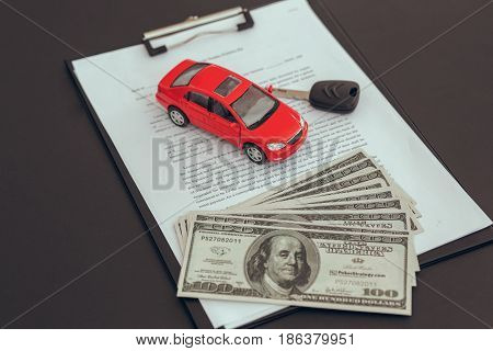 Leasing contract agreement and keys on the table car rental service