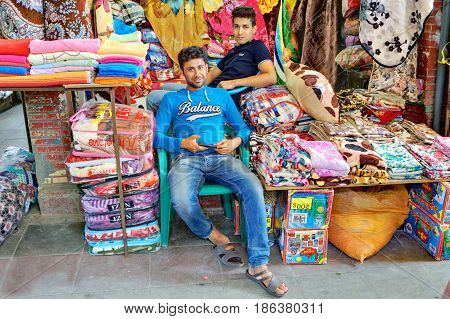 Bandar Abbas Hormozgan Province Iran - 16 april 2017: Two young Persian men trade textiles in the Grand Bazaar.