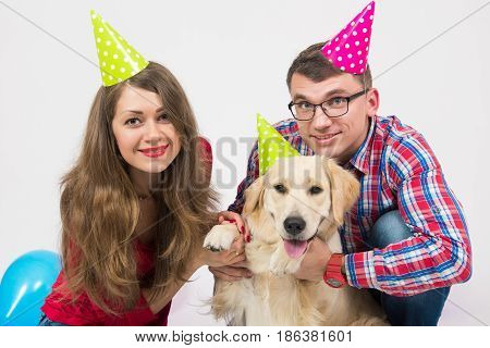happy couple and their dog celebrate one year birthday in studio