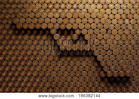 MOSCOW, FEB,14, 2017: Gun bullet pistol round cartridge shell background abstract pattern pistol contour symbol relief emboss. Kalashnikov rifle gun bullets rounds cartridge shells 9 mm caliber Luger