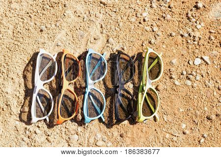 Set Of Sunglasses On The Sand. Concept For Sumer, Vacation Post