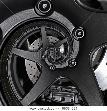 Sport car automobile wheel abstract fractal brake disk tire close up spiral effect pattern background. Automotive abstract car wheel tire spiral pattern background. Car abstract wheel metal spoke