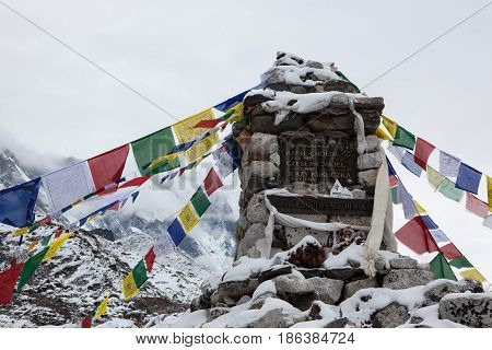 Everest Base Camp Trek/nepal - October 24, 2015: Buddhist Prayer Flags Under Snow On A Chorten Memor