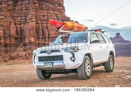 POTASH , UT, USA - MAY 7, 2017:  Toyota 4runner SUV (2016 trail edition) with a whitewater kayak on roof racks on a desert trail in the Moab area.