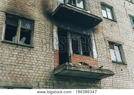 Burned apartment in a brick apartment house, outside view