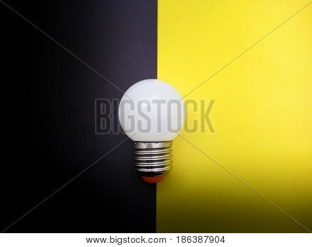 Light Bulb Simulating On and Off on Colored Paper