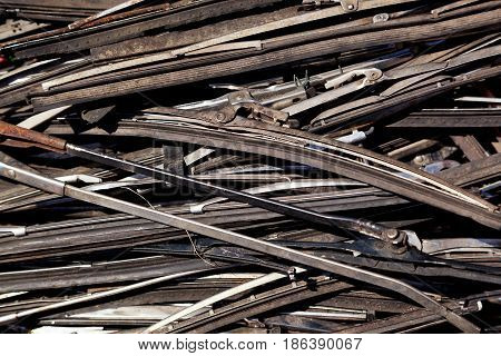 Background of a pile of used care wiper blades with space for text.