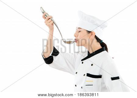 Professional Chef Holding A Spoon Trying
