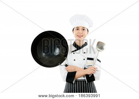 Female Chef Showing Wok And Spatula Tools