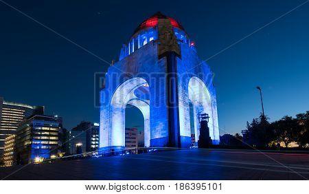 Monument to the Mexican Revolution (Monumento a la Revolución) located in Republic Square, Mexico City at night