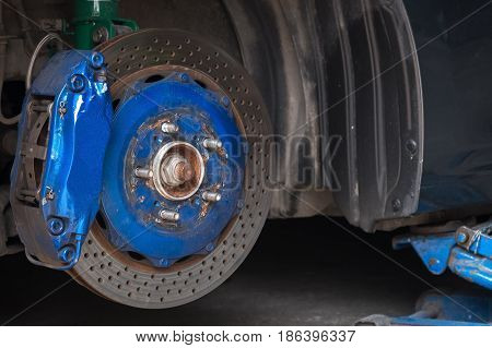 Front Disc Brake On Car In Process Of New Tire Replacement