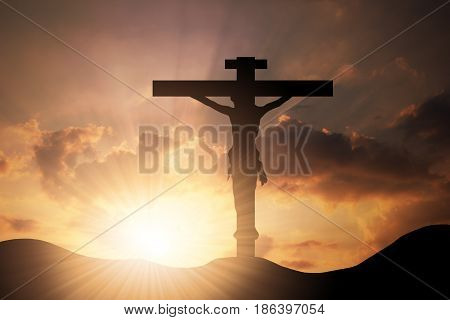 Conceptual wood cross or religion symbol shape over a sunset sky with clouds background for God belief or resurrection. Worship Christ Christianity religious faith holy spirit Jesus