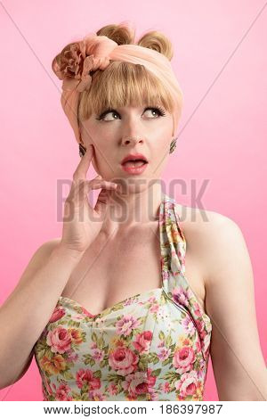 Cheeky pin up style shot - close up of model wearing vintage style clothing