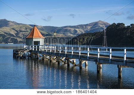 The landmark of Akaroa Daly's Wharf at sunset.
