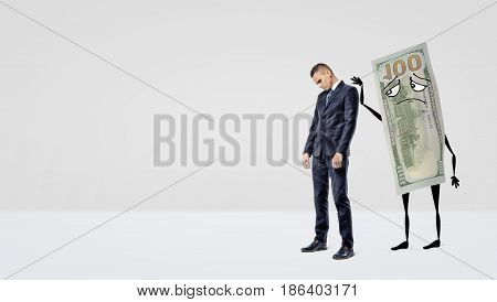 A sad businessman being assured by a large dollar bill with arms and legs that pats the man's back. Unfortunate operations. Loss of money. Investment return.