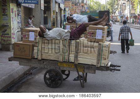 DELHI INDIA - JUN 10 : sleeping of worker before working time in old delhi of delhi on june 10 2015 india