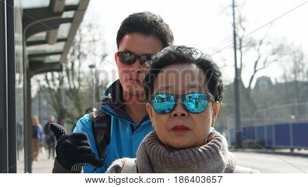 Asian Chinese Tourist Travel In Europe During Hoiday. Famous Destination Of Visitor From Asia