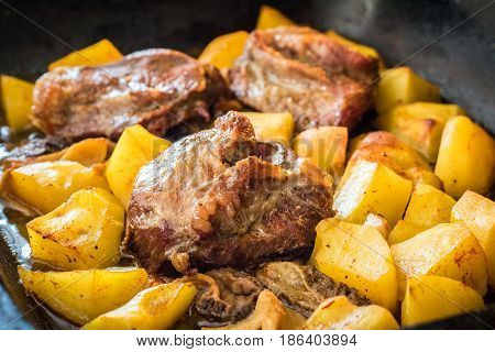 Shot Of Pork Roasted With Morel Mushrooms And Potatoes