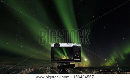Taking photo landscape of amazing beautiful natural phenomenon Aurora Borealis, in Iceland