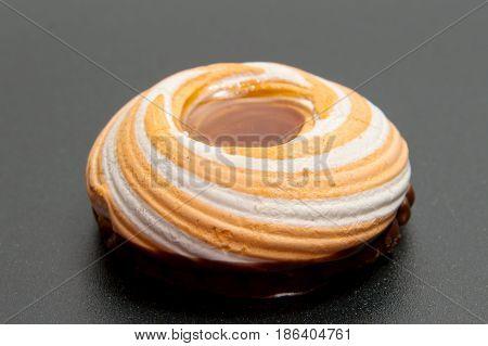 Pile of marshmallows glazed with chocolate. Many coated elegant zephyr dessert isolated on white. Sweet elegant dessert on a plate